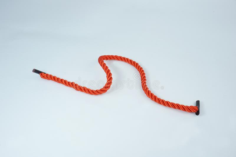 Red rope open on white background royalty free stock photography