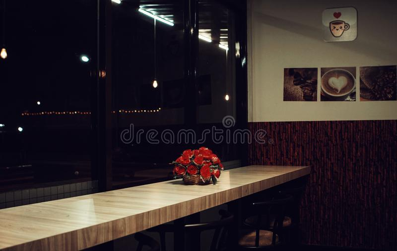 Red Rose Arrangement Decor on Brown Wooden Desk stock photography