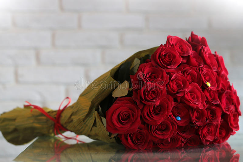 Red rose flowers bouquet stock photo. Image of brick - 61071648
