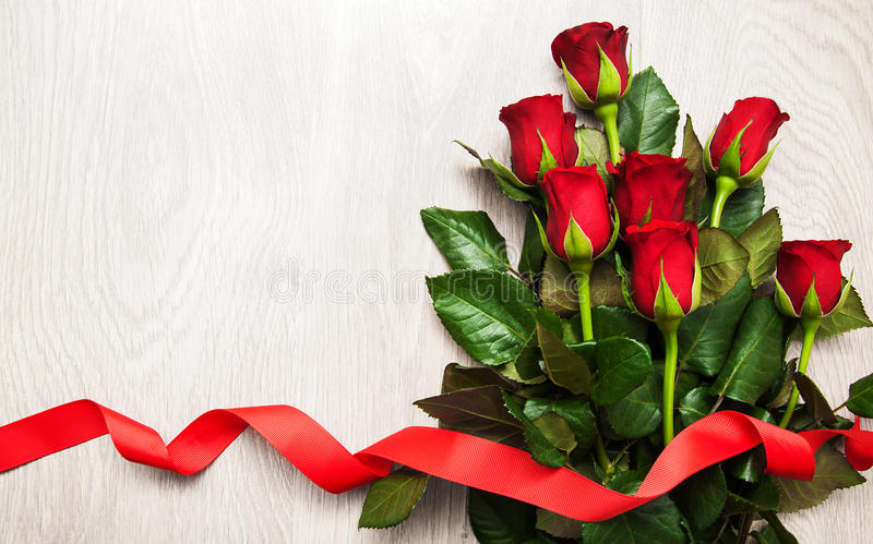 Red rose and hearts. Red rose with hearts on a old wooden table stock photos