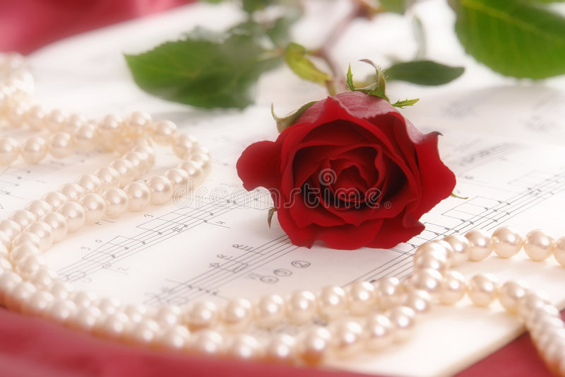 Red rose and pearls stock image