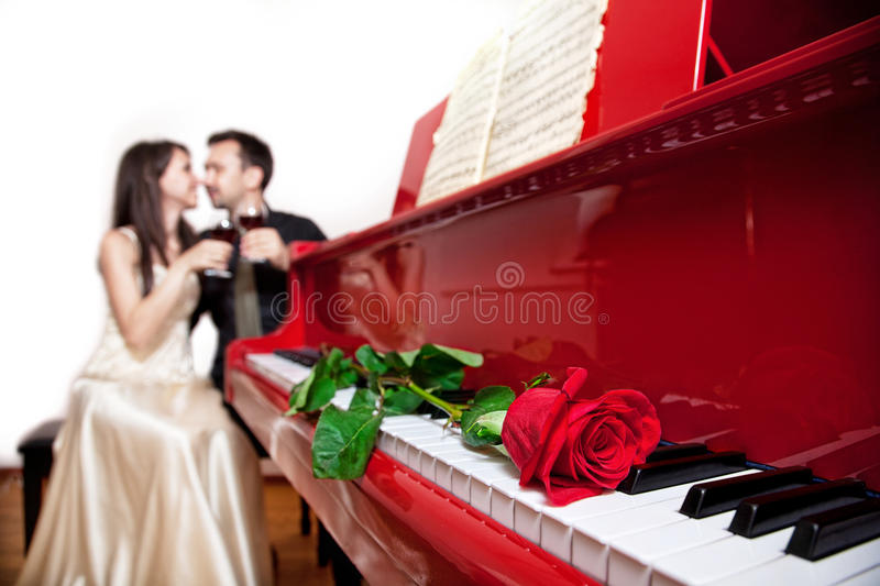 Red rose on piano stock images