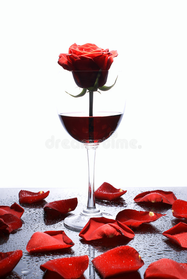 Red rose and red wine royalty free stock photo