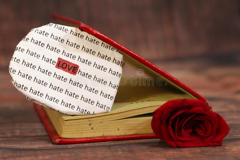 Red rose with text heart. Red rose with text heart in a red book stock photography
