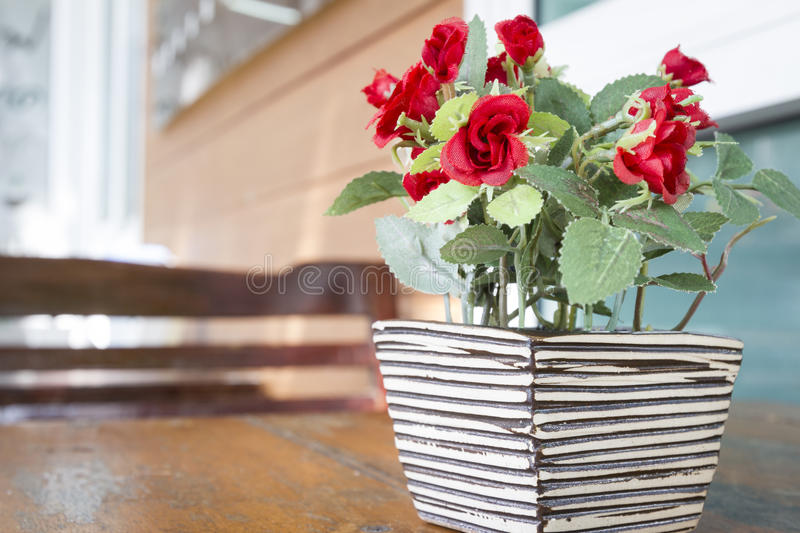Red Rose Vase Decorate. On Table royalty free stock photography