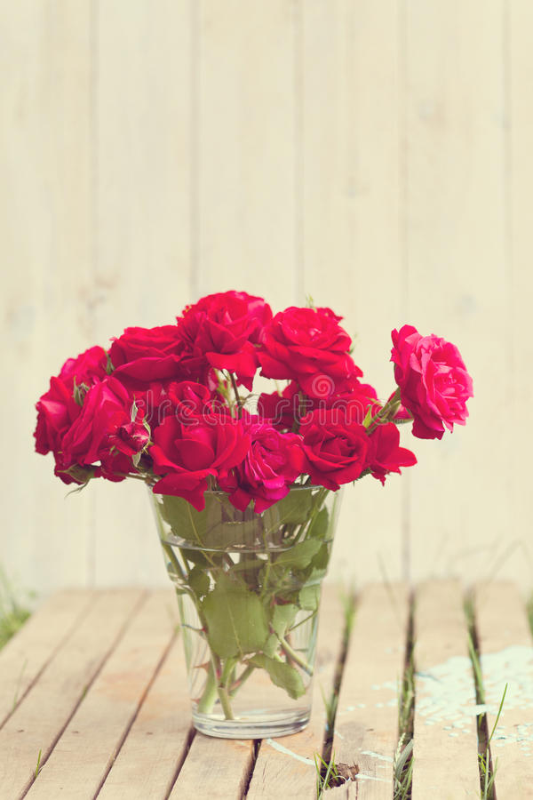 Red roses bouqet outdoor. Vintage image of red roses bouqet outdoor stock image