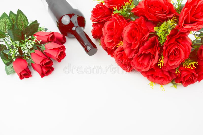 Red Roses Bouquet And Red Wine Bottle. On White Background St. Valentine`s Day Present Empty Space royalty free stock images