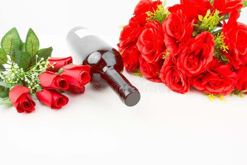 Red Roses Bouquet And Red Wine Bottle stock photography