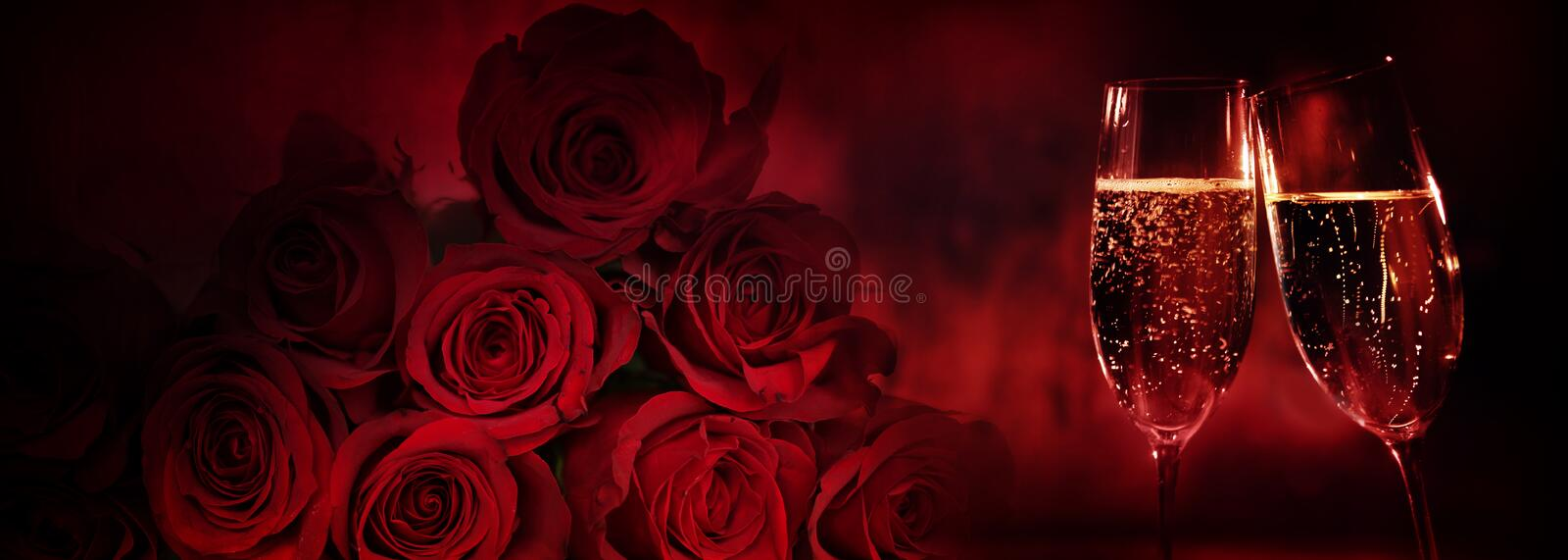 Red roses with champagne stock images