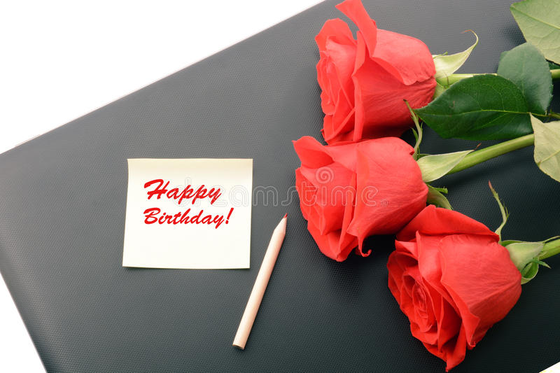 Red roses closeup on a laptop. Happy Birthday card stock photography