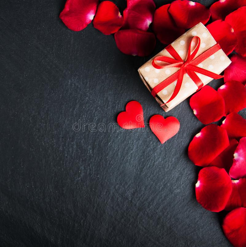 Red roses and gift box royalty free stock photo