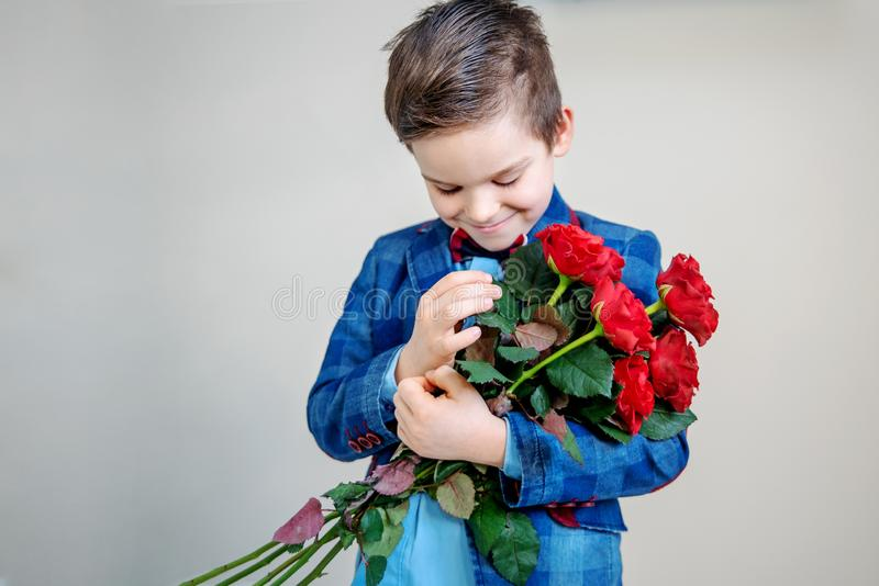 Red roses in hands royalty free stock photo