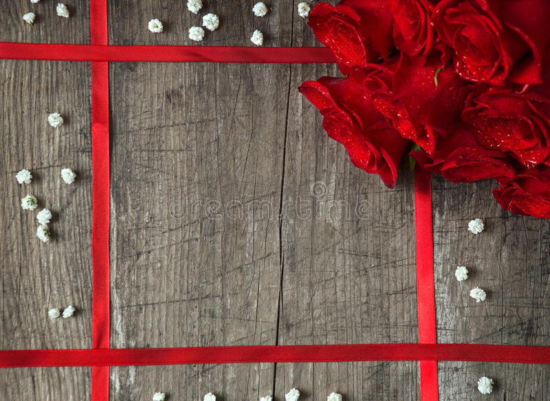 Red roses with ribbon stock photography