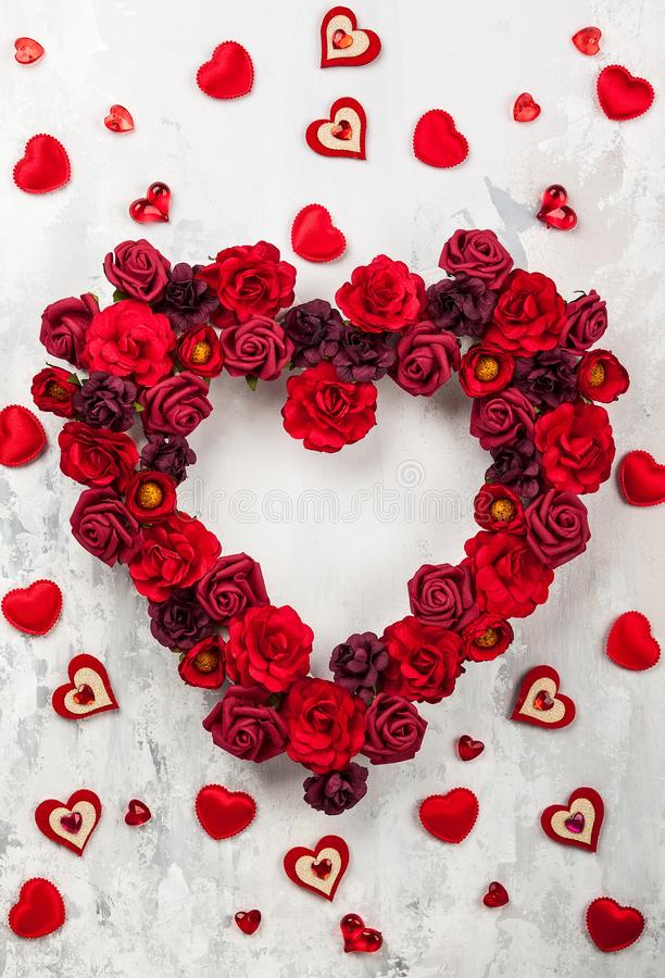 Red roses in shape of heart. On the light gray vintage background stock photos