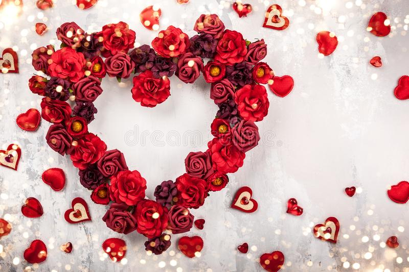 Red roses in shape of heart. On the light gray vintage background royalty free stock photos