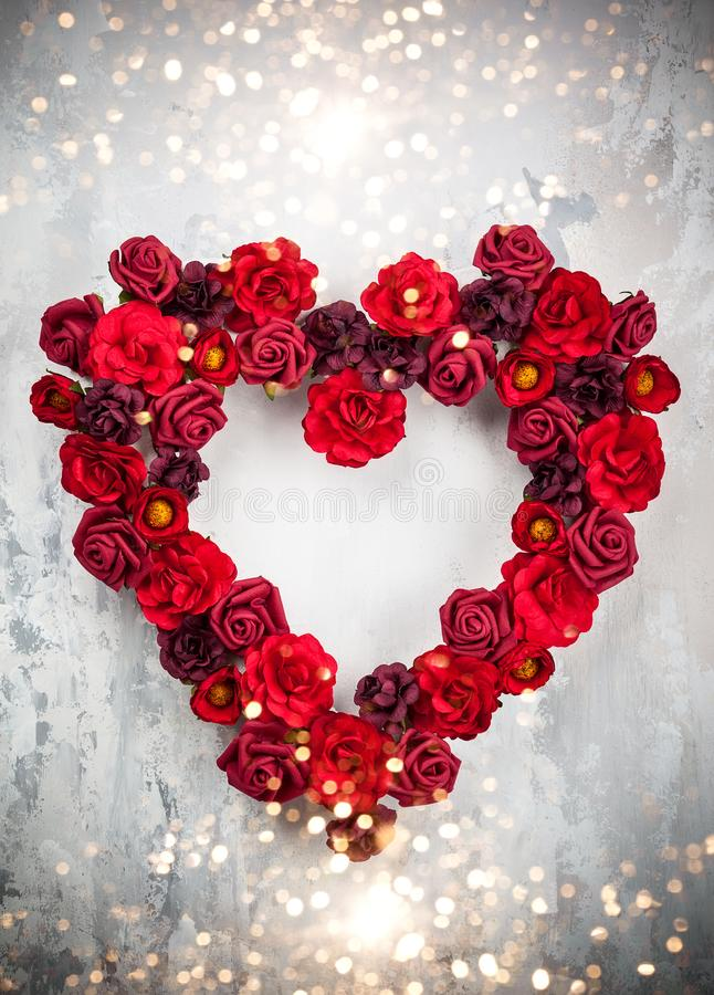 Red roses in shape of heart. On the light gray vintage background stock images