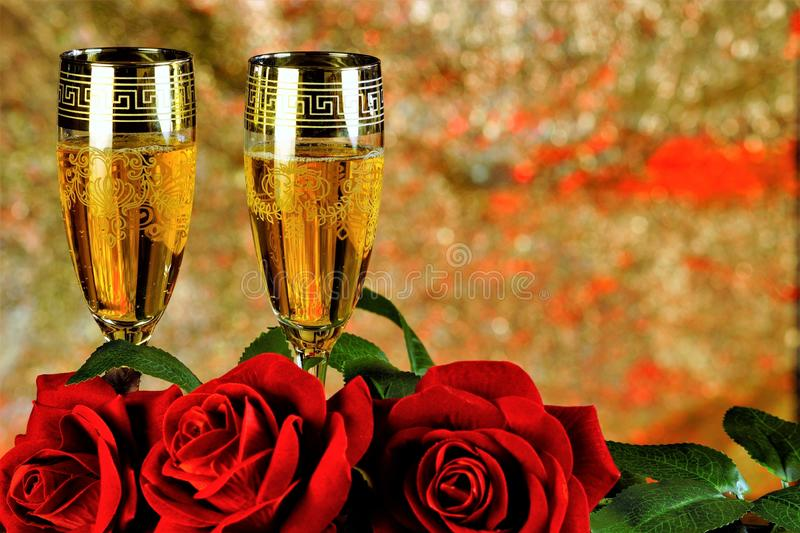 Red roses and wine, bokeh background-a celebration of love and fun. Red roses symbol of love, wine symbol of fun, Valentine`s stock photos