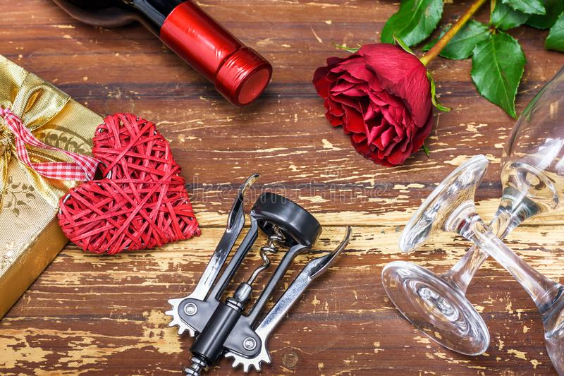 Red roses, wine set, heart and gift box. Valentine`s Day stock photo
