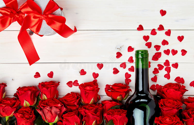 Red roses and wine on white background royalty free stock photo