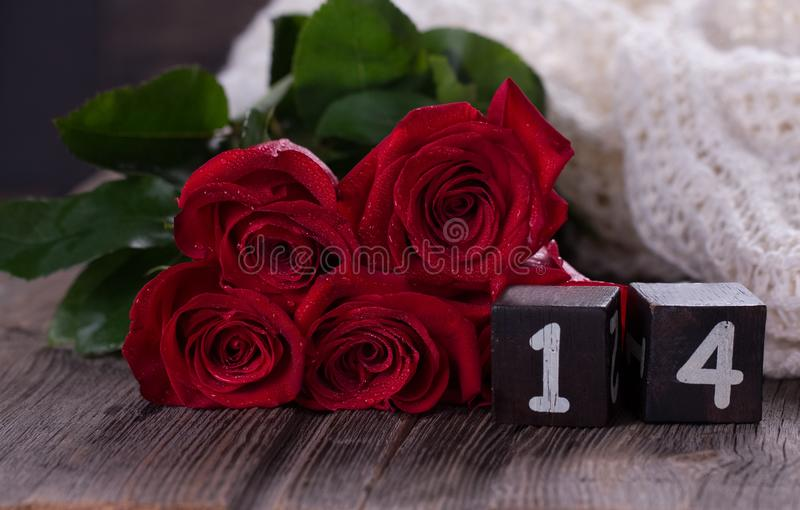 Red roses on wooden planks. Valentines day background royalty free stock photography