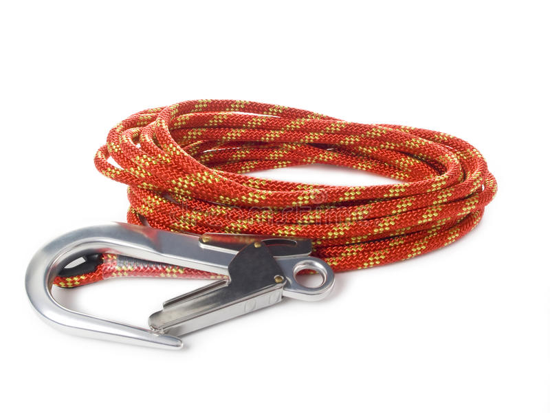 Red roupe and carabiners. On white royalty free stock images