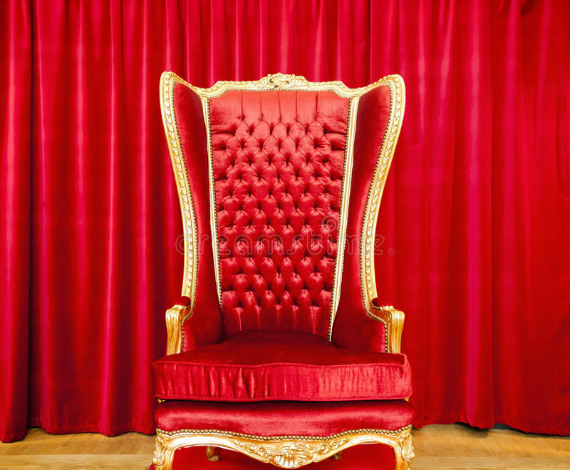Red royal throne. And red curtain behind royalty free stock photography