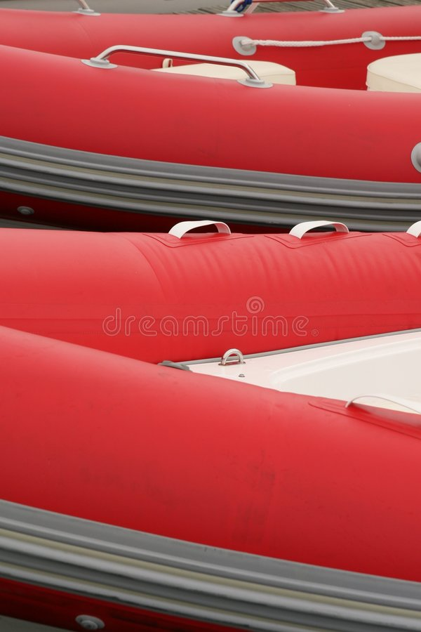 Red rubber boats royalty free stock photos