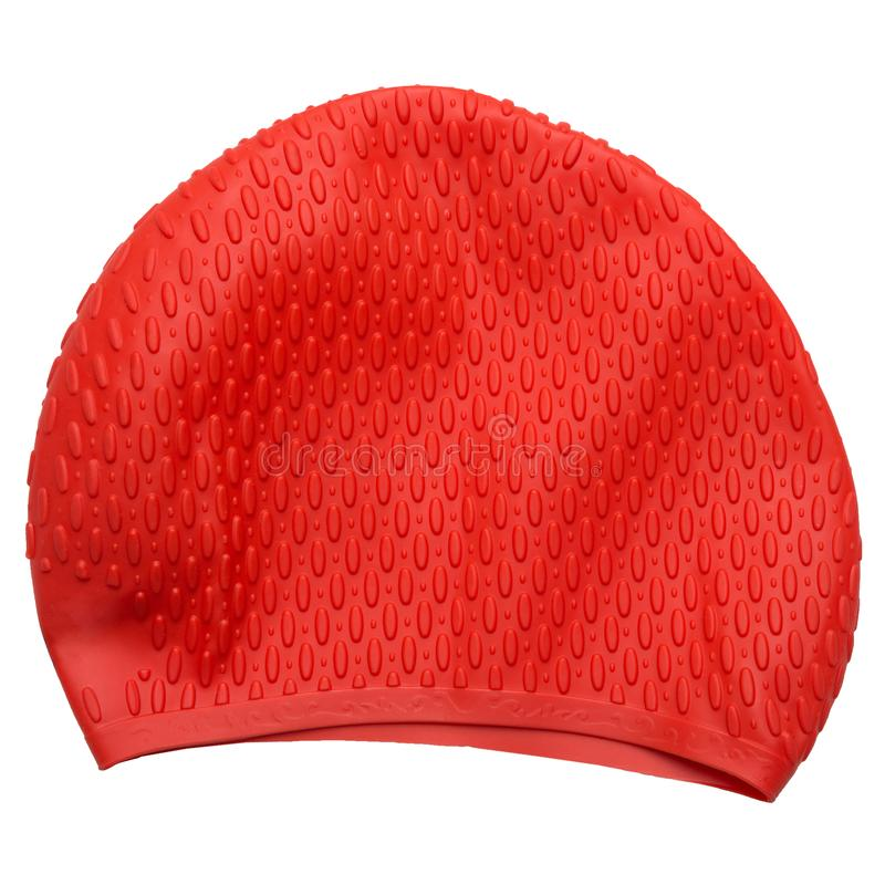 Red rubber cap for swimming in the pool or in the open water, on a white background, isolate. Red rubber cap for swimming in the pool or in the open water, on a royalty free stock images