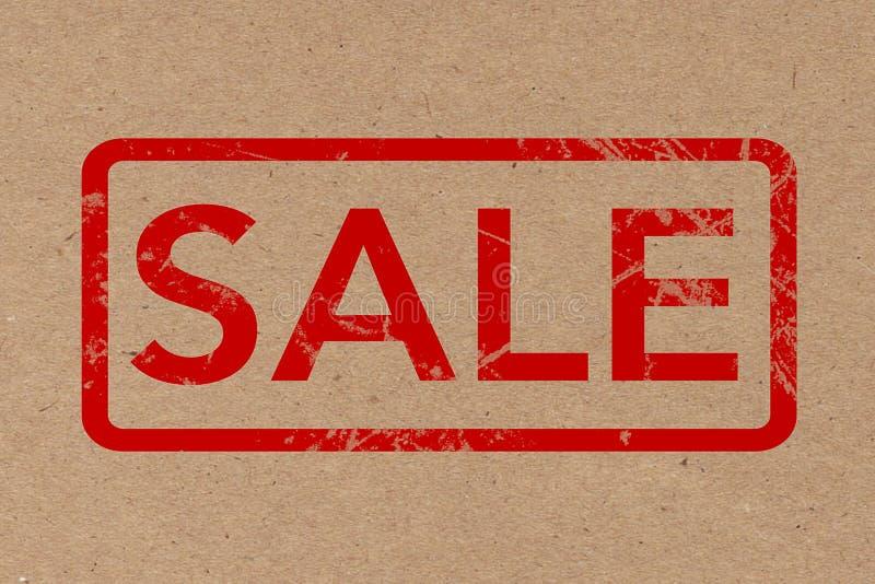 Red Rubber Sale Grunge Stamp over Cardboard. 3d Rendering royalty free illustration