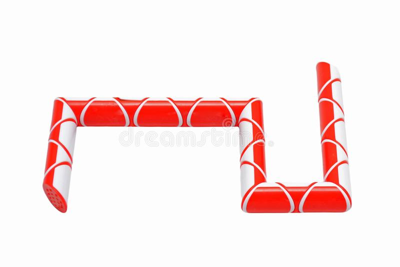 Rubik`s snake puzzle toy on white. Red Rubik`s puzzle snake logic toy on white background royalty free stock images