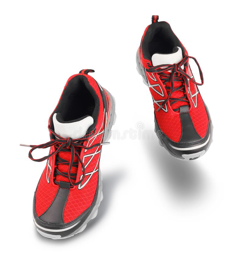 Red running sport shoes going forward stock image