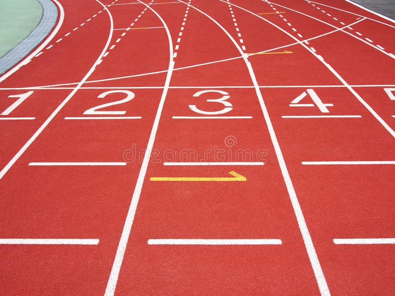 Red running track. With numbers at the stadium royalty free stock photography