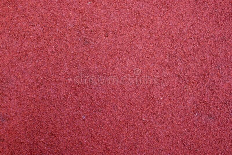 Red running track texture. Sport background stock image