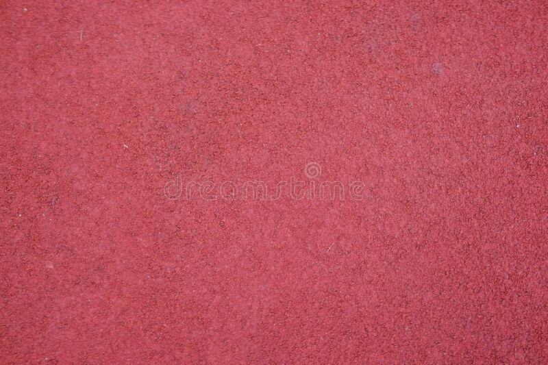 Red running track texture. Sport background stock photos