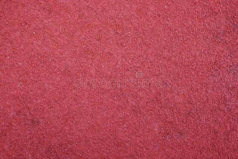 Red running track texture. Sport background royalty free stock image