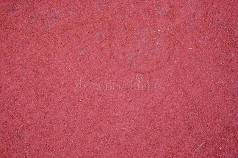 Red running track texture. Sport background royalty free stock photography