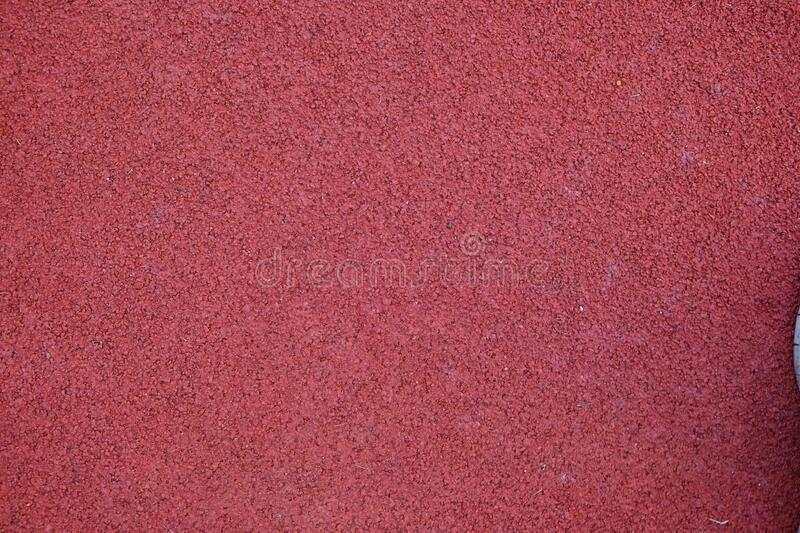 Red running track texture. Sport background royalty free stock images
