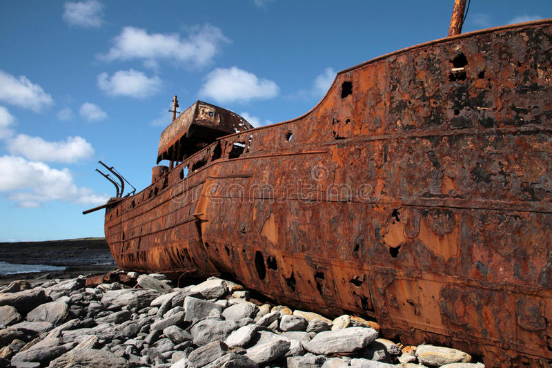 Red rust on old sank boat in Inisheer, Aran Islands stock photos