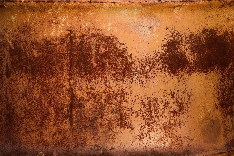 Red rust pattern on metal barrel stock image