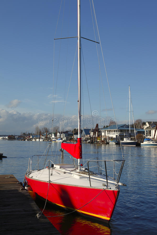 A red sailboat. A red sailboat moored in a bayou in Portland Oregon stock photo