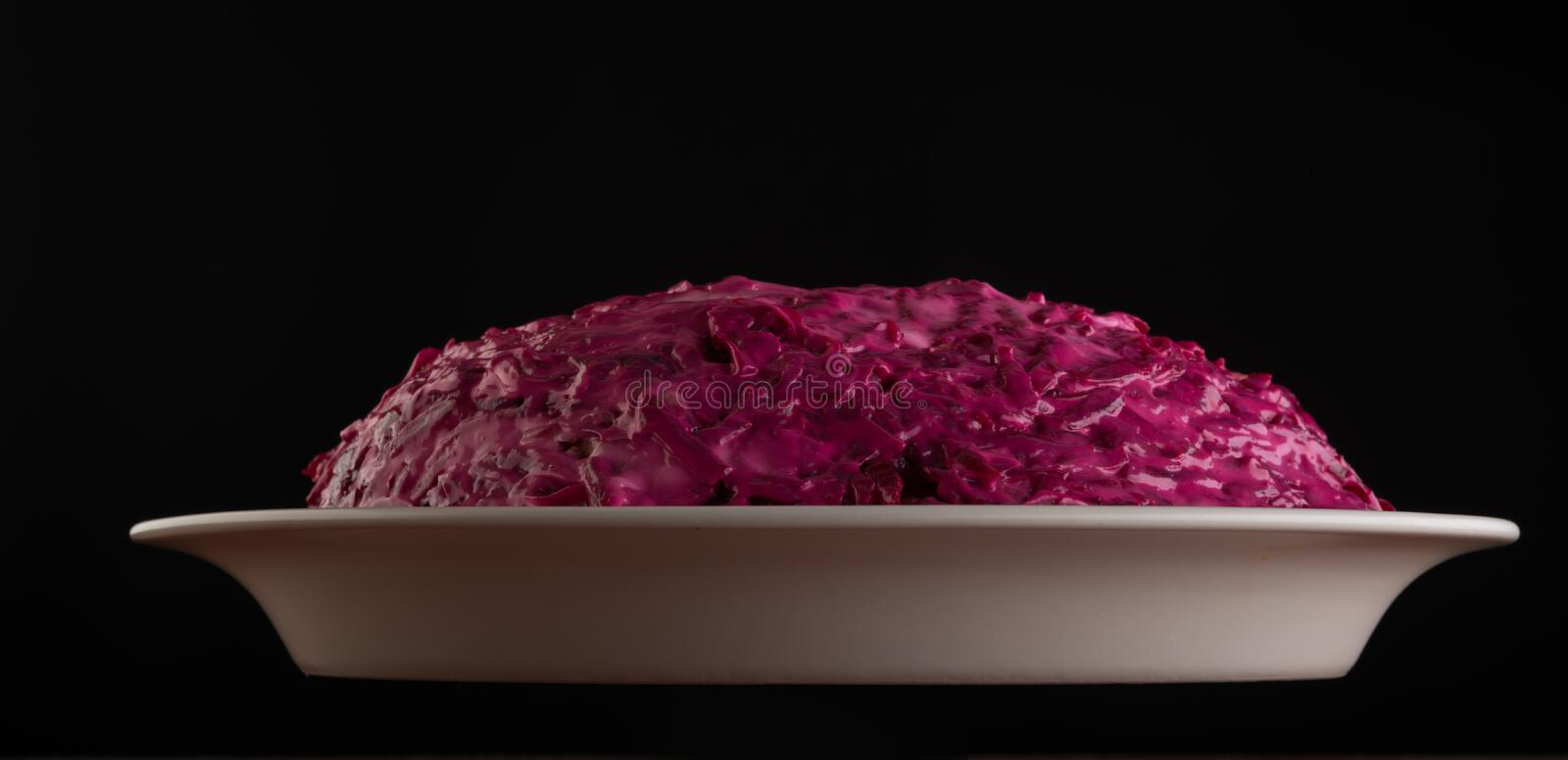 Red salad on black background royalty free stock images