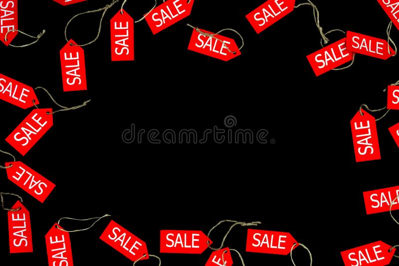 Red sale and discount shop labels isolated on black bakcground with space for text during black friday holiday in fashion shop royalty free stock photography