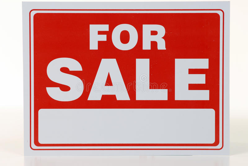 Red sale sign. Red for sale sign on store front royalty free stock image