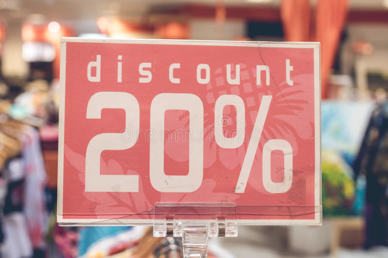 Red sale sign 20 percent discount on blurred background in a shopping mall of Bali, Indonesia, Asia. Red sale sign on blurred background in a shopping mall of stock image