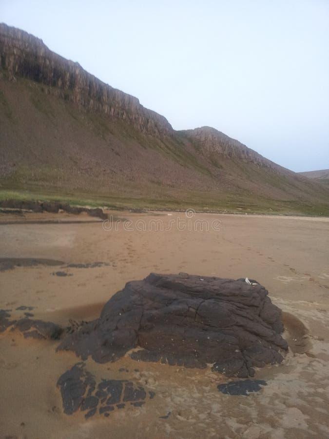 Red sand beachside stock photo