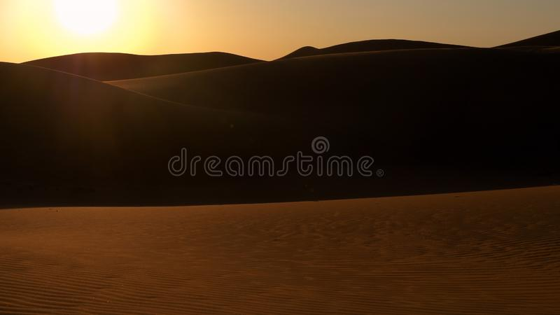 Red sand dunes in the Arabian desert at the sunset stock image