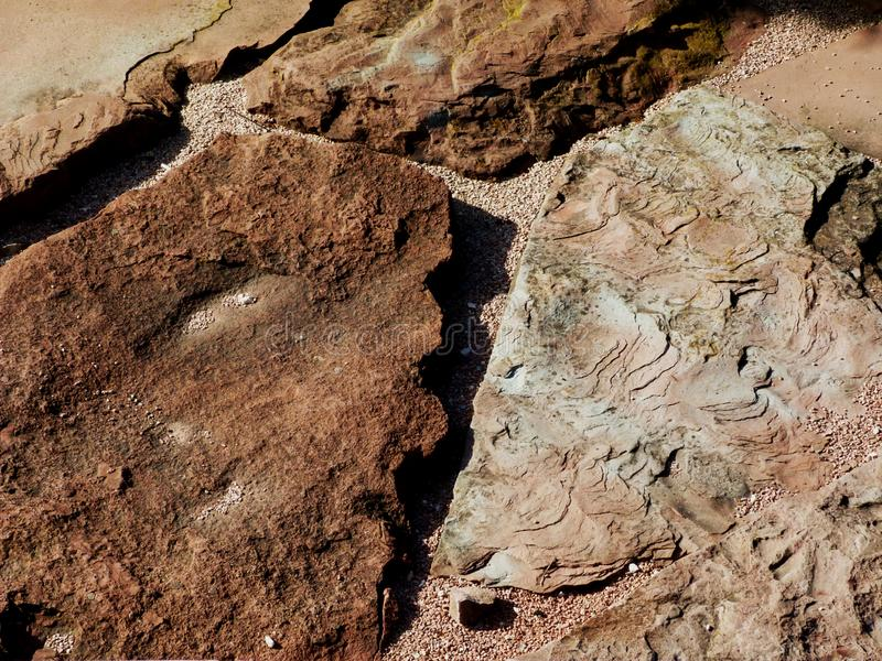 Red sand stone paving with rustic rough layered split surface and strong grit texture. Natural brown quartz or sand stone type of paving with rustic rough royalty free stock photo