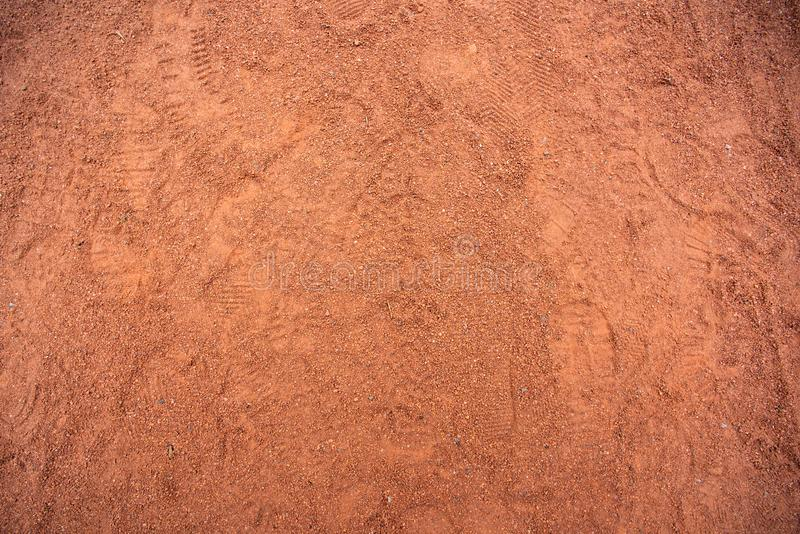 Red sand texture with shoe prints on top. Red sand texture with shoe prints, nature, dry, background, desert, textured, surface, abstract, outdoor, rough stock photos