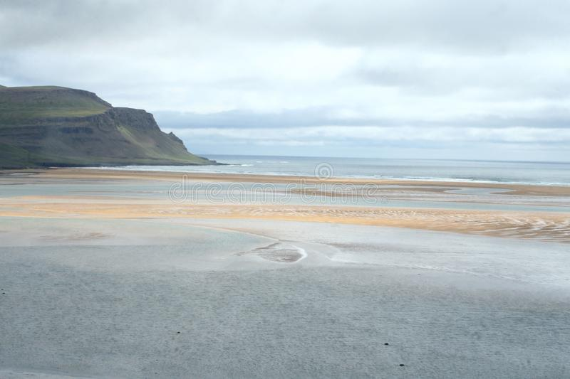 Red sand in western fjords in Iceland stock photos