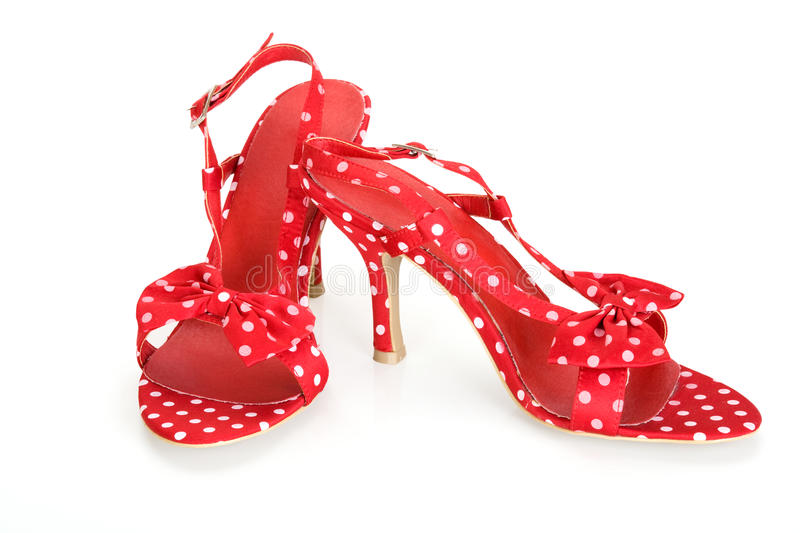 Red sandals in a pea. On a white background stock image